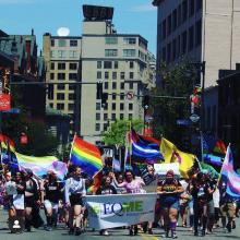 Image of a group of young people marching in the Portland Pride parade
